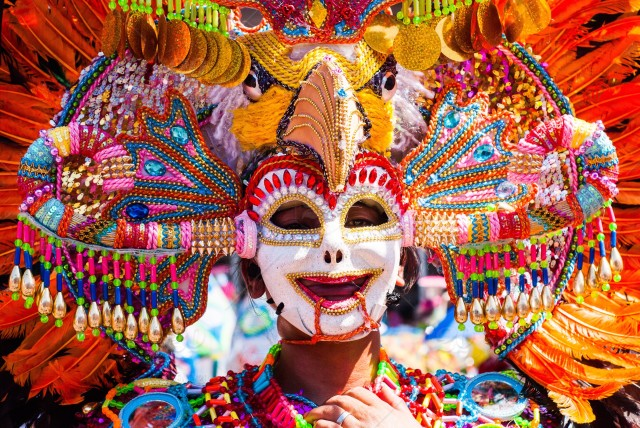 stock-photo-smile-philippines-mardi-gras-colors-headdress-mask-festival-mardigras-street-dance-9c32a56b-ee10-4735-a231-ff46197080ac